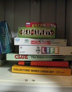 picture of board games in a white cabinet