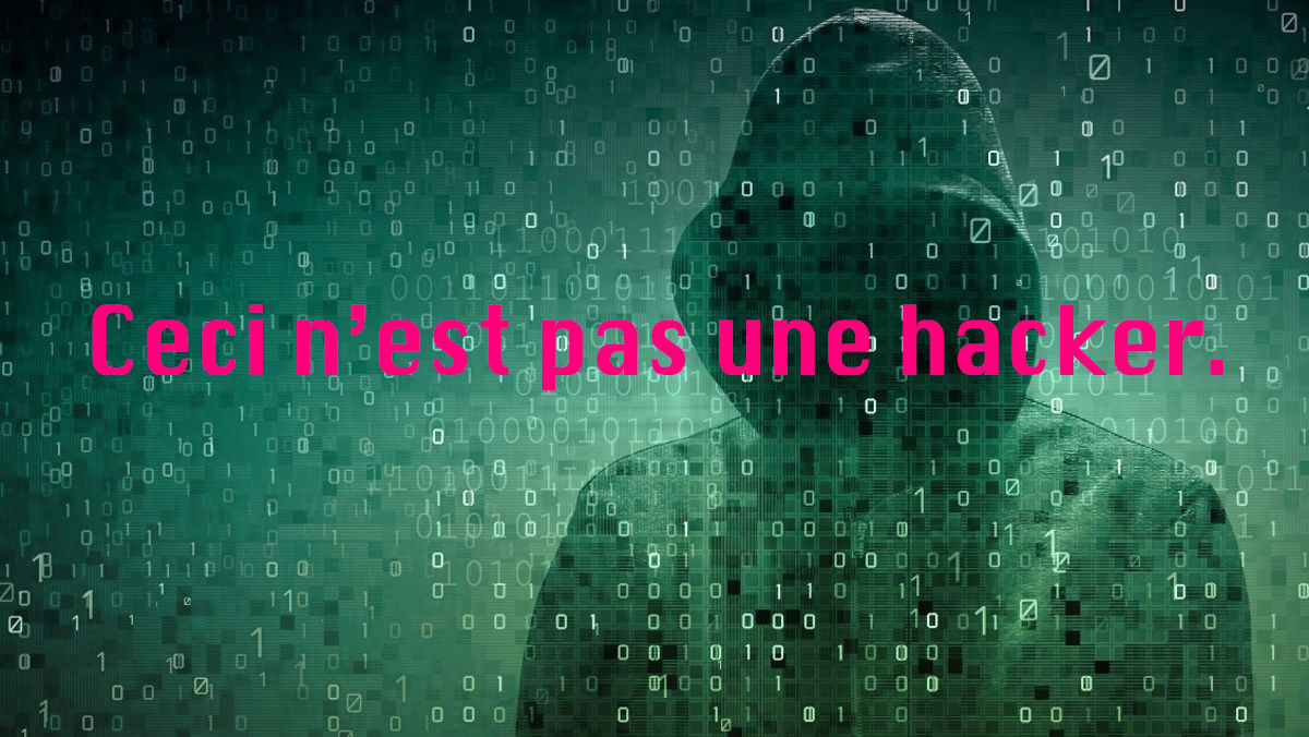 A hoodie with no face visible, 1's and 0's with pink text stating - Ceci n'est pas une hacker.