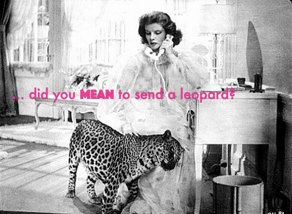 woman on telephone with a leopard at her side. pink caption reads did you MEAN to send a leopard?