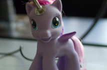 Child's play pony with a soldering iron horn