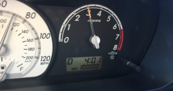car odometer reading 100,000 miles