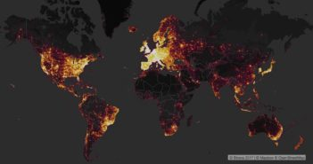 A map of the word where the oceans are dark greay and the continents are black. Some parts of the world glow almost white, though. These areas represent data hot spots for the Strava fitness tracker. Europe, coastal US, Japan, South Eastern Australia are all brightly shaded.