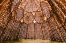 Twigs in geometric patterns make up a woven dome