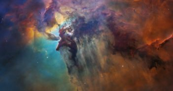 A multicolored cloud in space with starts peeping through