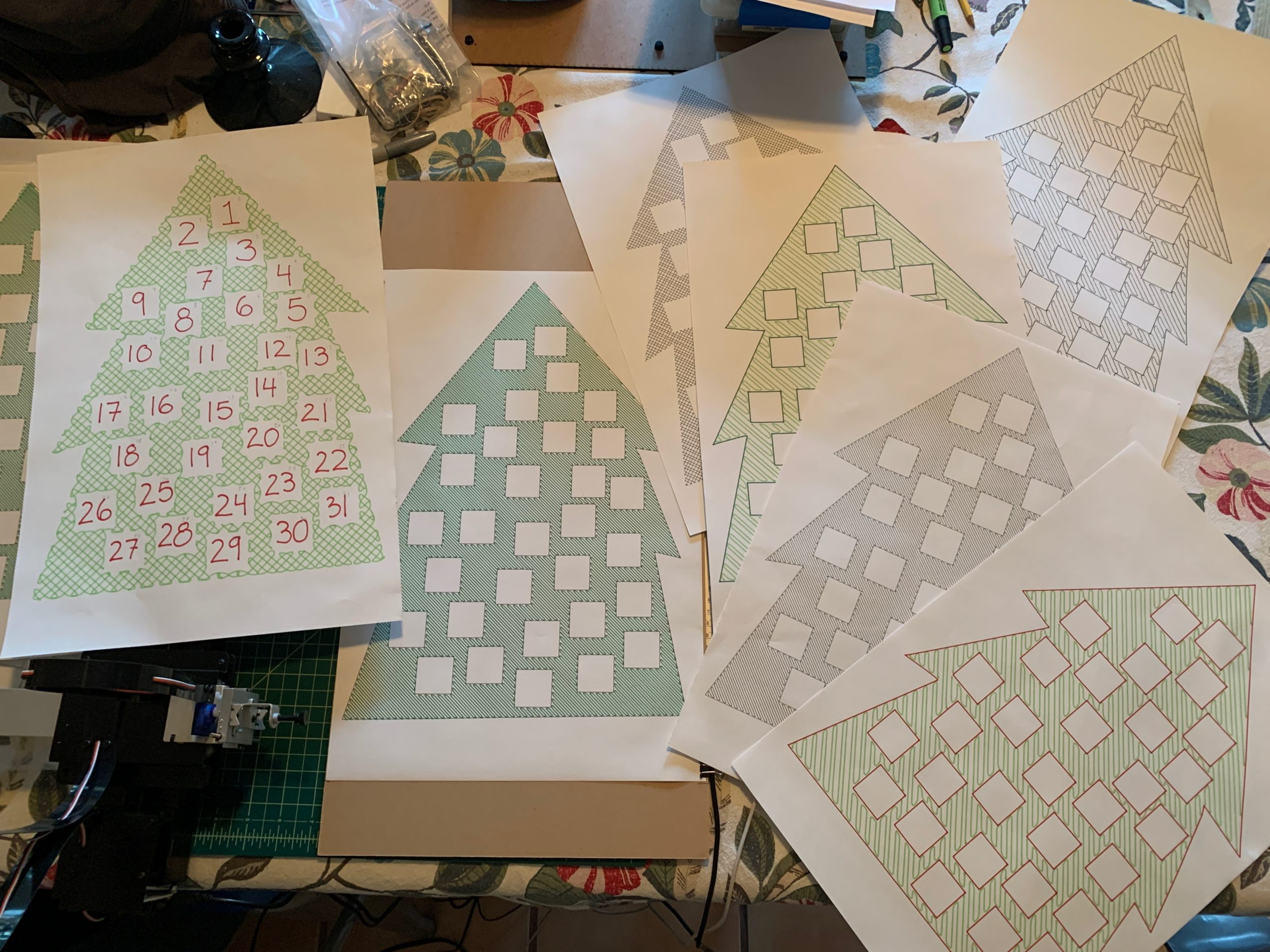 a collection of cartoon like fir trees with boxes cut out of them